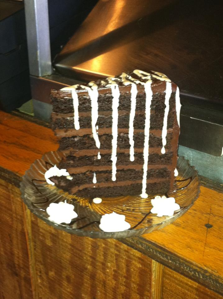 large slice of chocolate cake with icing