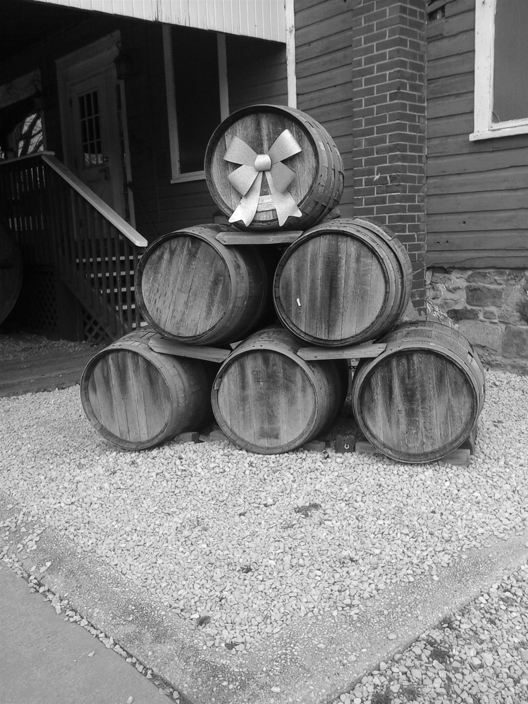 vintage photo of multiple wine barrels stacked together