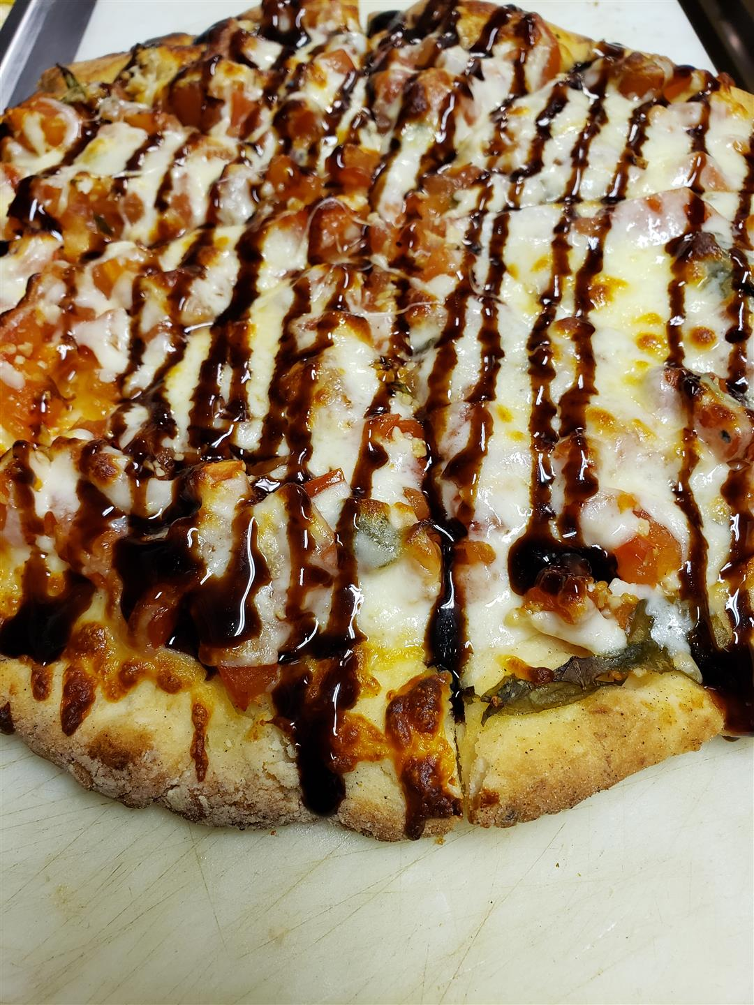 cauliflower crust pizza wuth cheese and bbq sauce