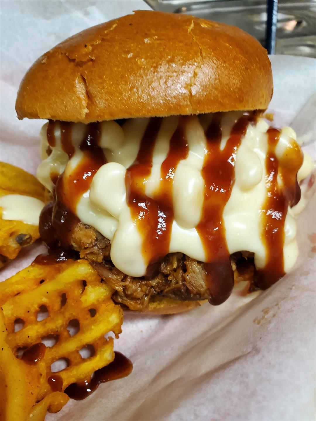 pulled pork burger with barbeque sauce and melted cheese
