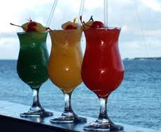 Drinks lined up on railing overlooking the ocean