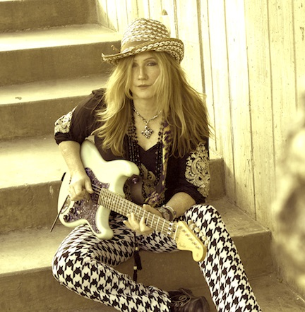 Jodee on the stairs with a guitar
