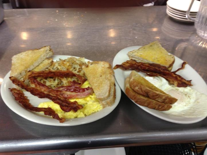 two plates of various breakfast items