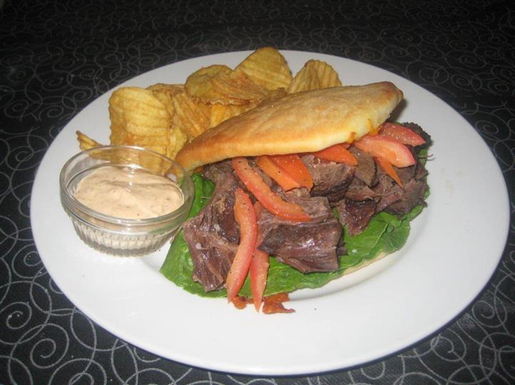 roast beef sandwich with chips