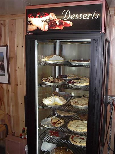 A fridge with desserts