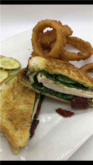 chicken sandwich with Sundried Tomatoes, Pesto, Havarti, Fresh Spinach on Grilled Sourdough