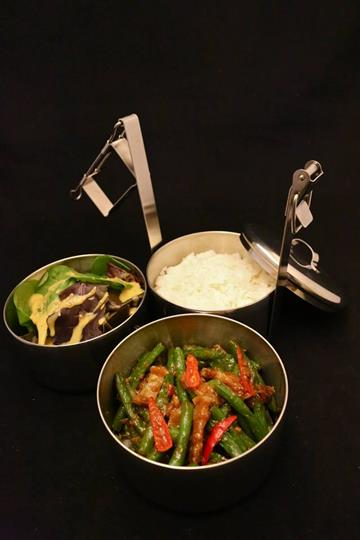 Vegetables and rice in pots