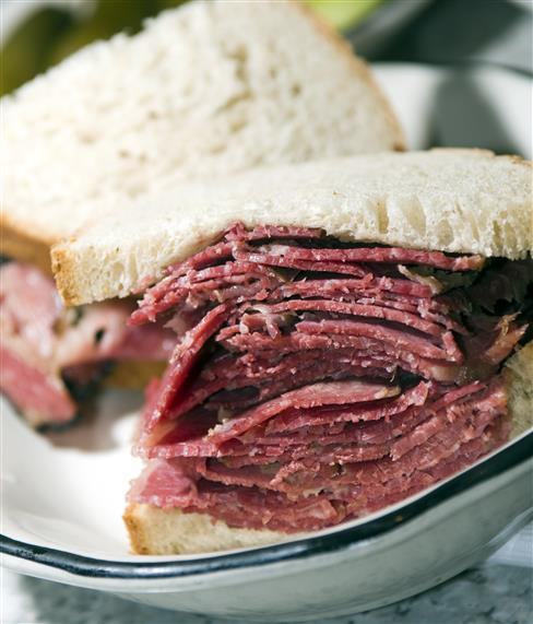 corned beef piled high on rye bread