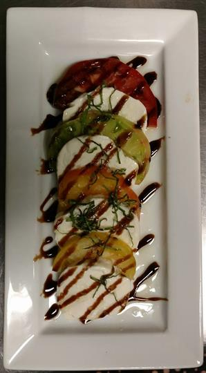 Chef specialty dish drizzled with sauce