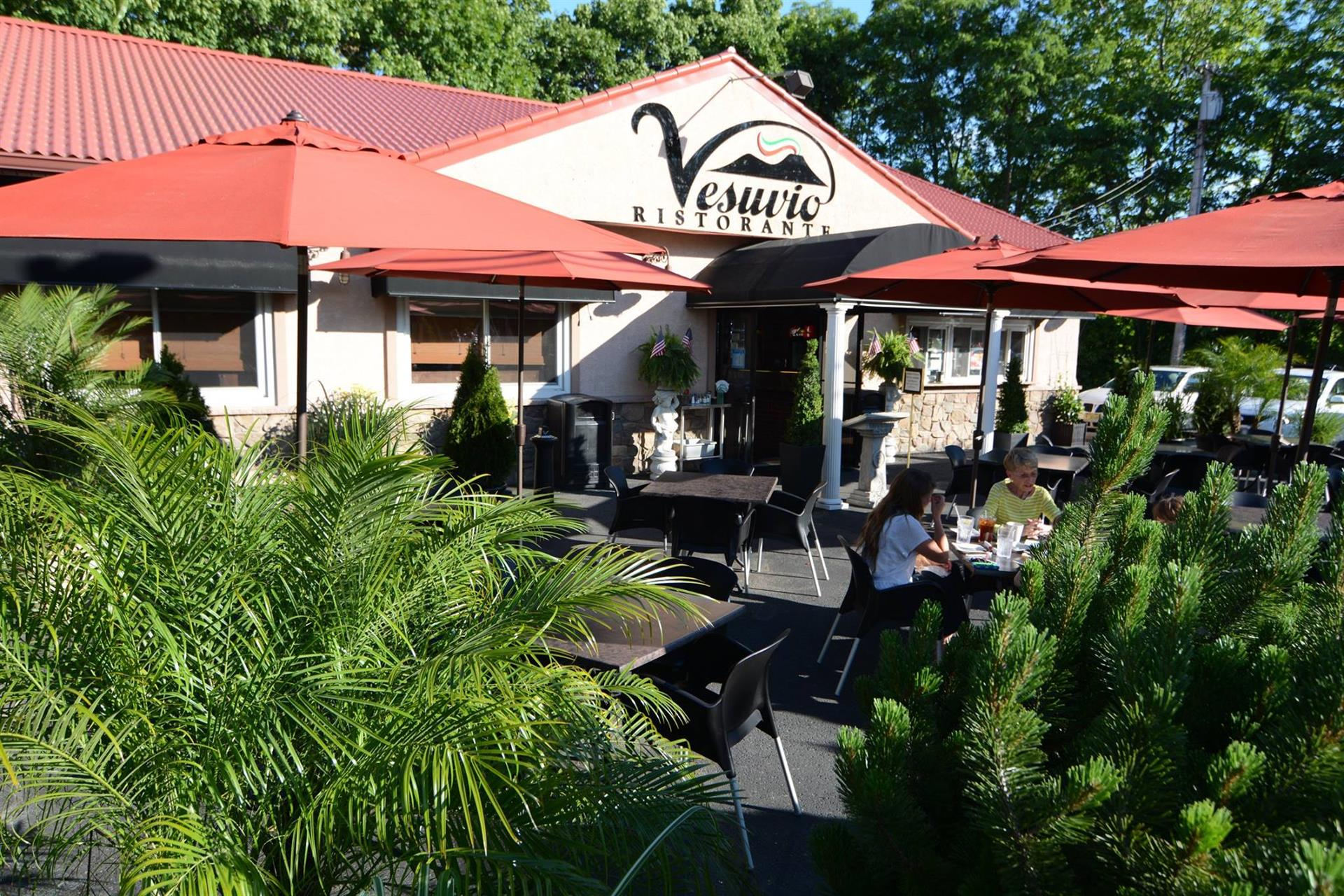 outside of Vesuvio Ristorante - view of the entrance with tables and umbrellas for shade