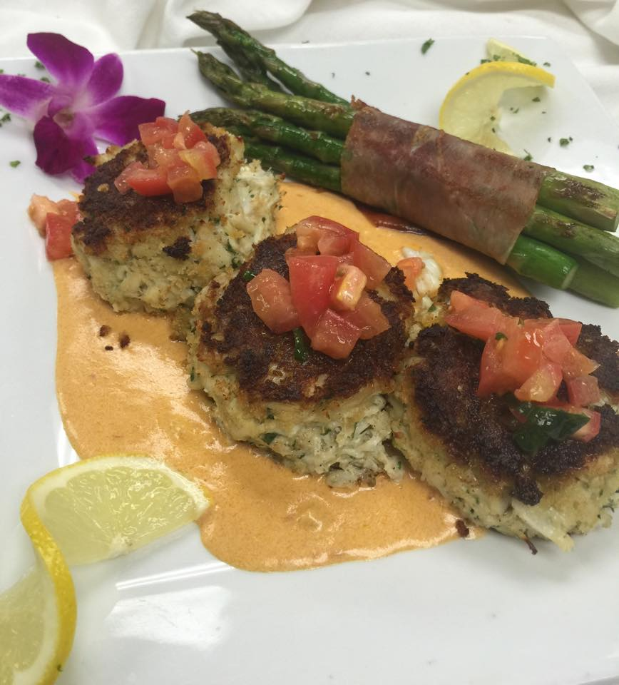 mini crab cakes with a side of asparagus wrapped in bacon