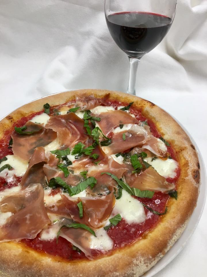 pizza with red sauce, mozzarella and prosciutto