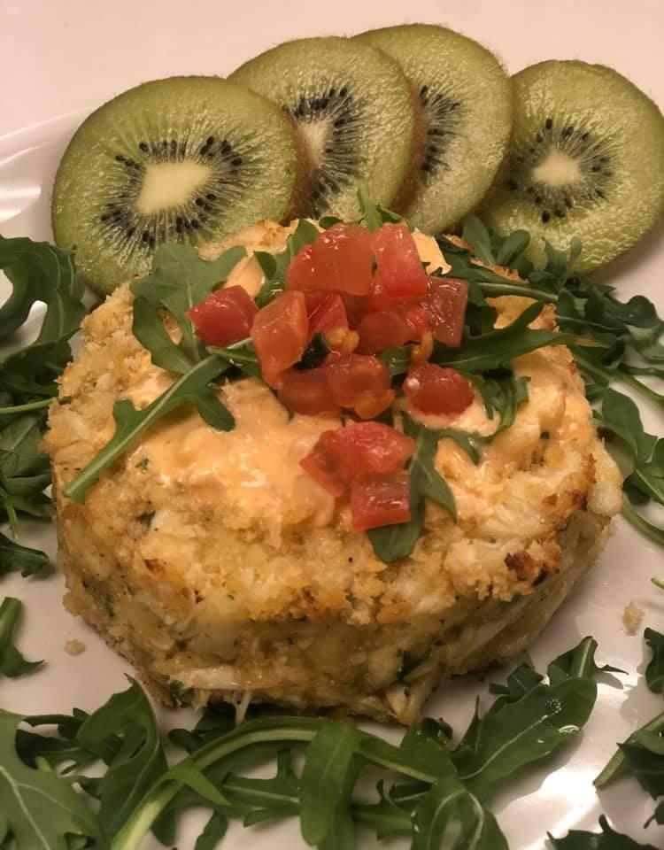 Crab cake with kiwi on the side