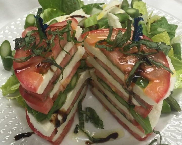 Caprese: Fresh Mozzarella, Garlic, House made Roasted Red Peppers, Tomatoes, and Drizzled with Olive Oil