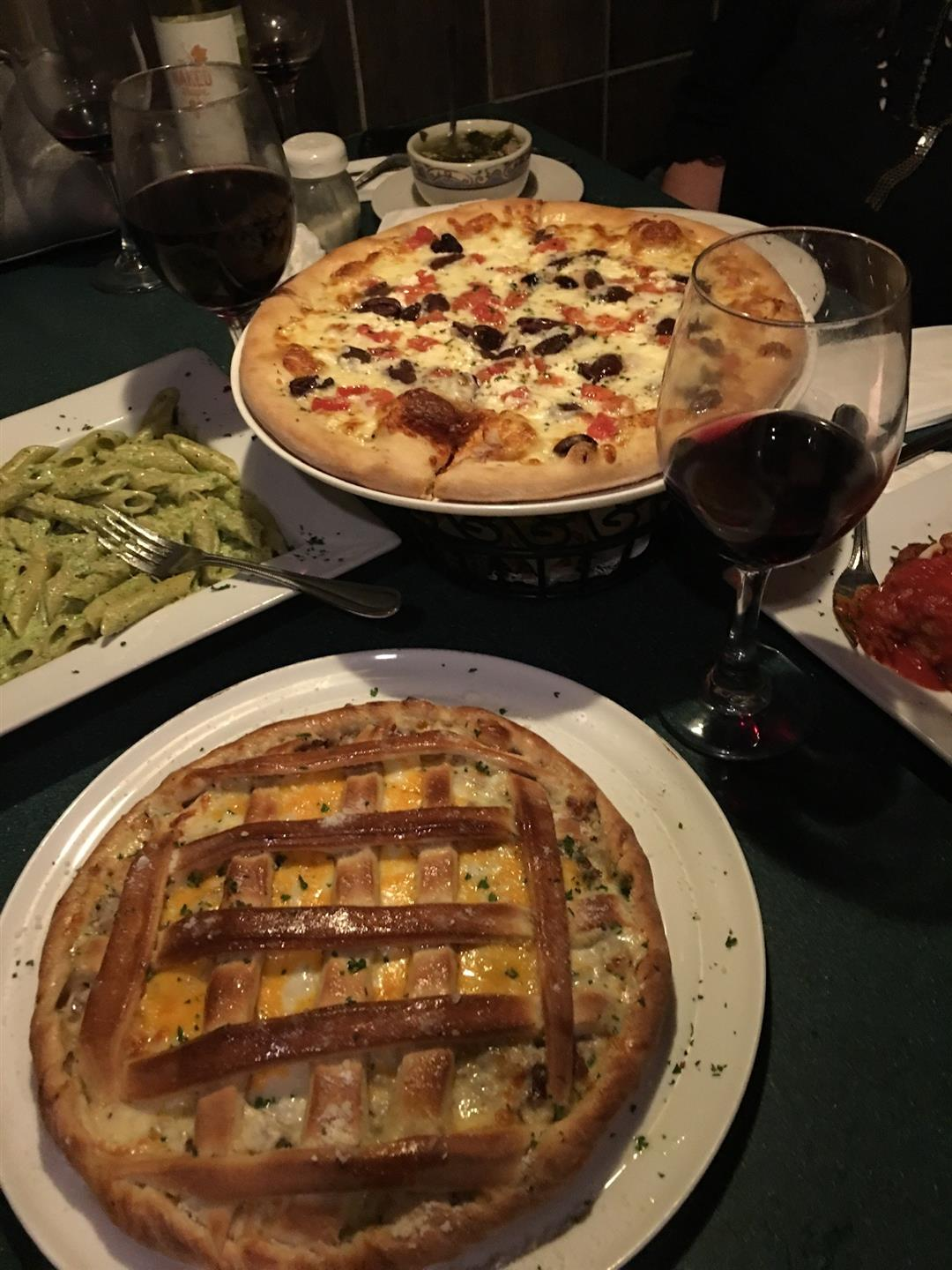 assorted pizzas and pastas on a table