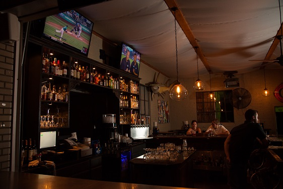 side view of bar area with two televisions