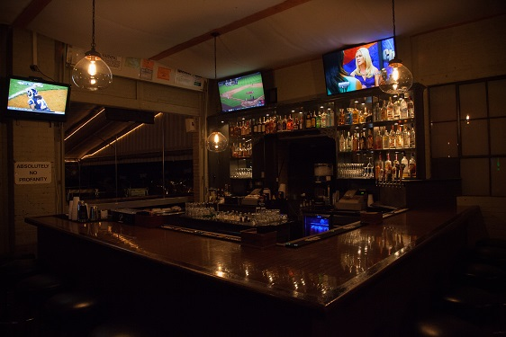 another view of bar area with televisions