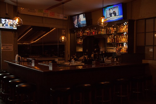 view of bar area with televisions