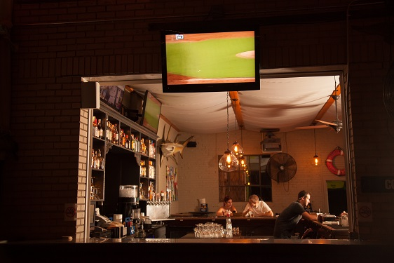 view of bar with television