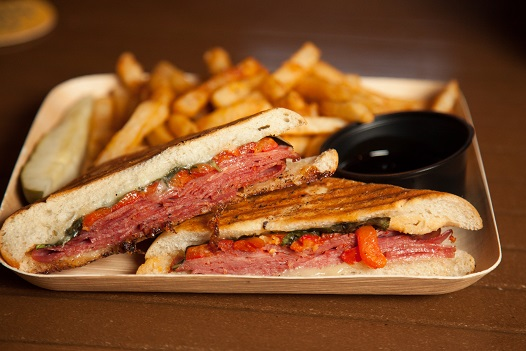 Italian Panini  Cappicola, salami, provolone, mozzarella, basil, roasted peppers,balsamic reduction, foccacia with dipping sauce, pickle and french fries