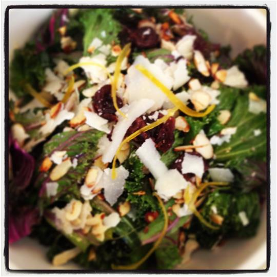 side salad topped with cranberries and grated cheese