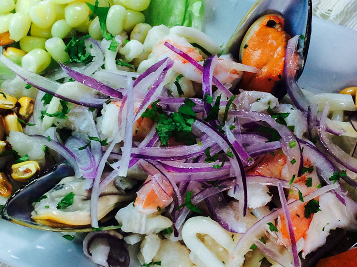 fresh seafood entree with calamari, mussels and vegetables