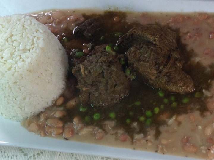 marinated beef in sauce with white rice on the side