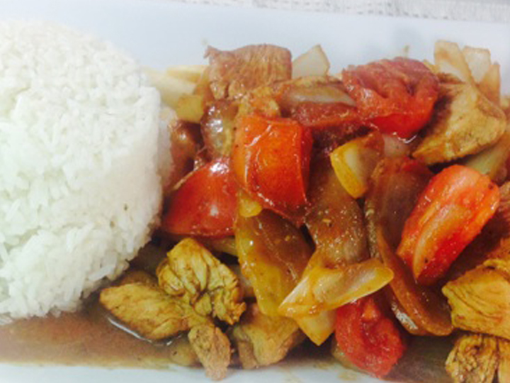 cooked chicken with vegetables and a side of rice