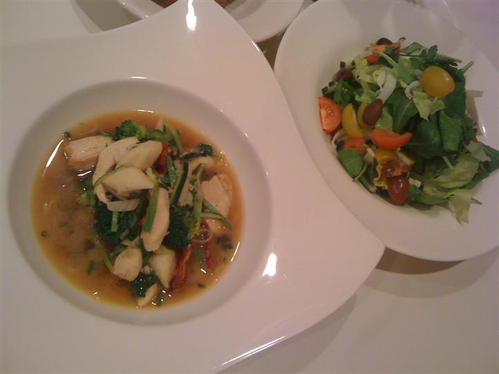 chicken soup with spinach and vegetables with a side salad