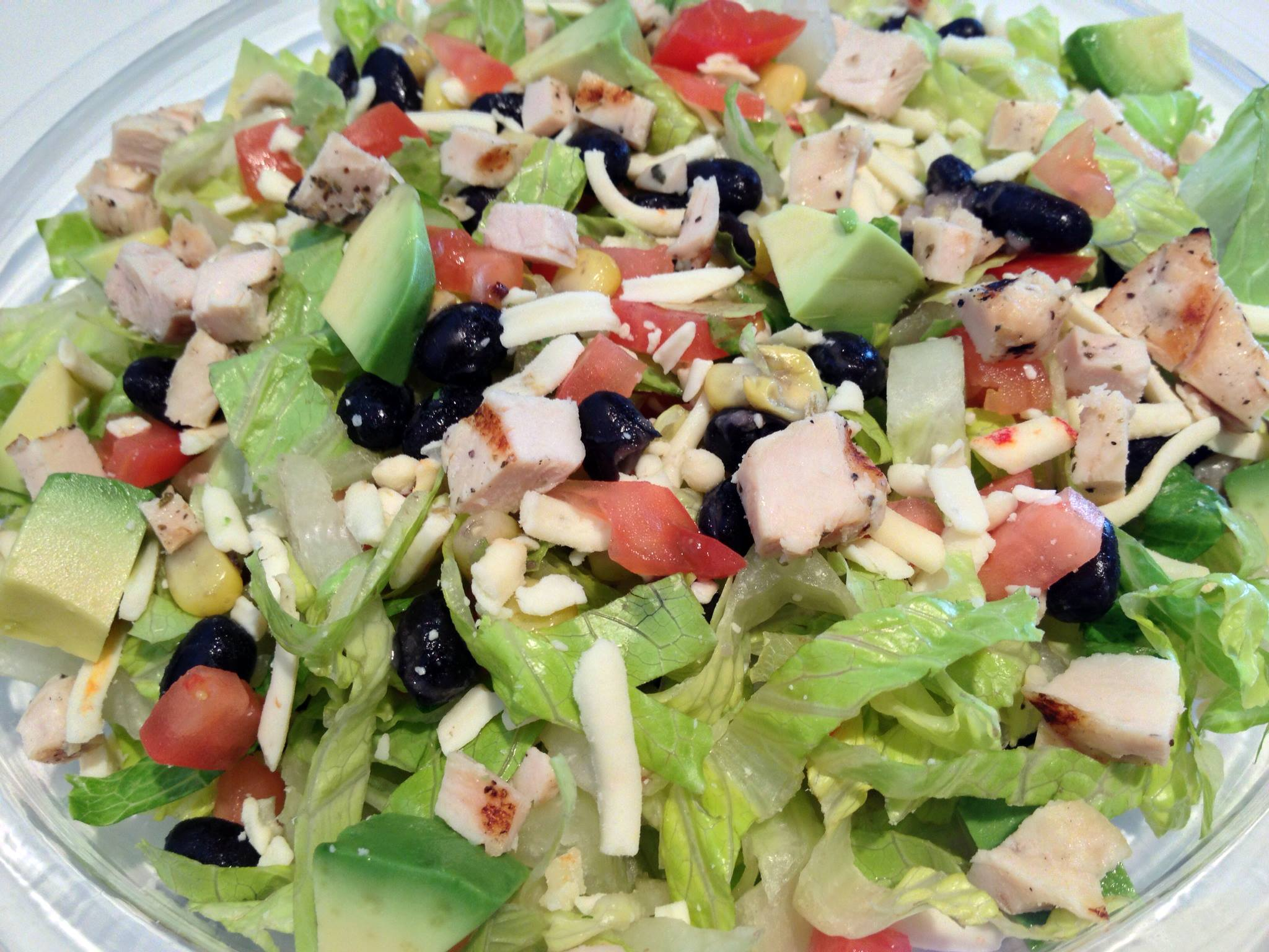 Salad with vegetables, meat, and cheese