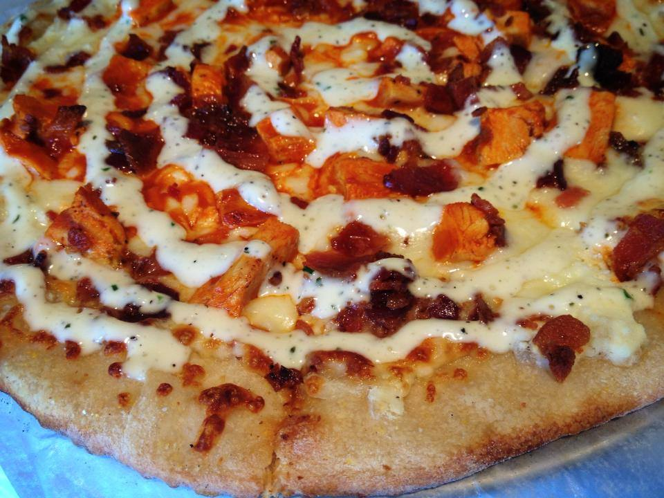 Pizza pie with chicken, ranch, and bbq sauce