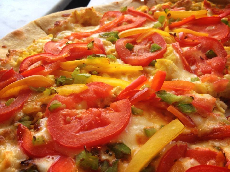 Cheese pizza pie topped with peppers