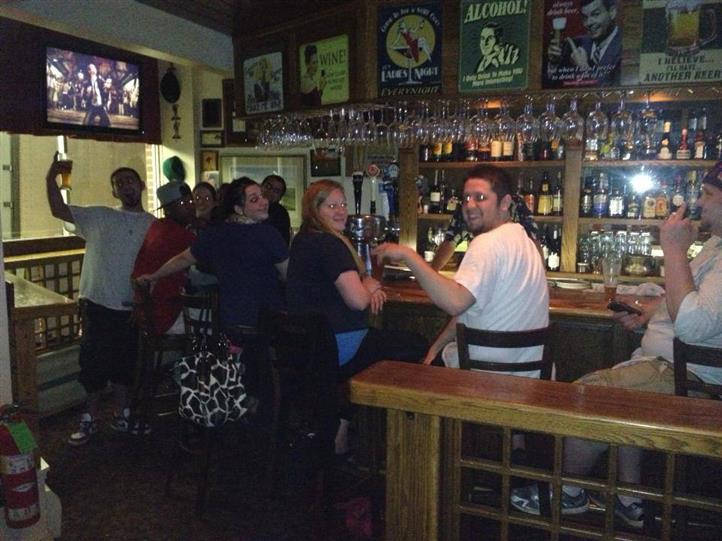 crowded bar area during happy hour