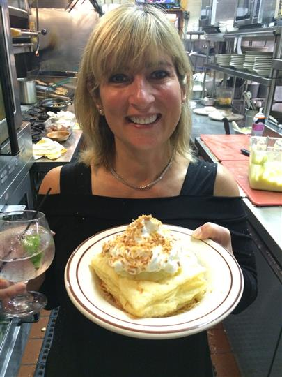woman holding a dessert plate with a cocktail