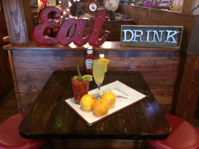 Eat drink sign with a bloody mary on the table