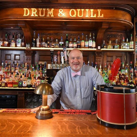 Kevin Drum behind the bar of Drum & Quill