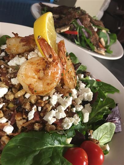 Romaine lettuce and grated cheese tossed in salad with added grilled shrimp