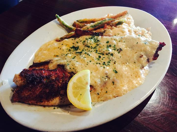 Sauteed Mahi with our signature creamy white wine, craw fish, crab and corn sauce. Served over Mashed Potatoes