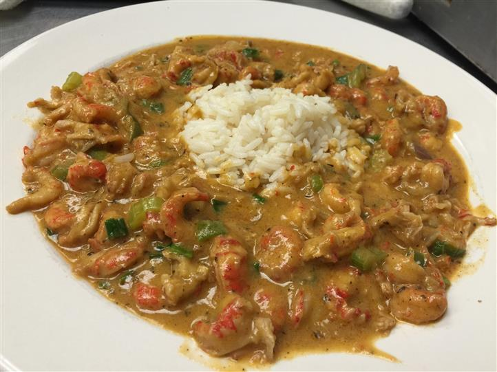 Sauteed crawfish tails, onions, peppers and celery in a blonde roux served over rice.