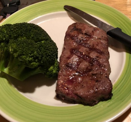 Grilled steak on a plate with broccoli