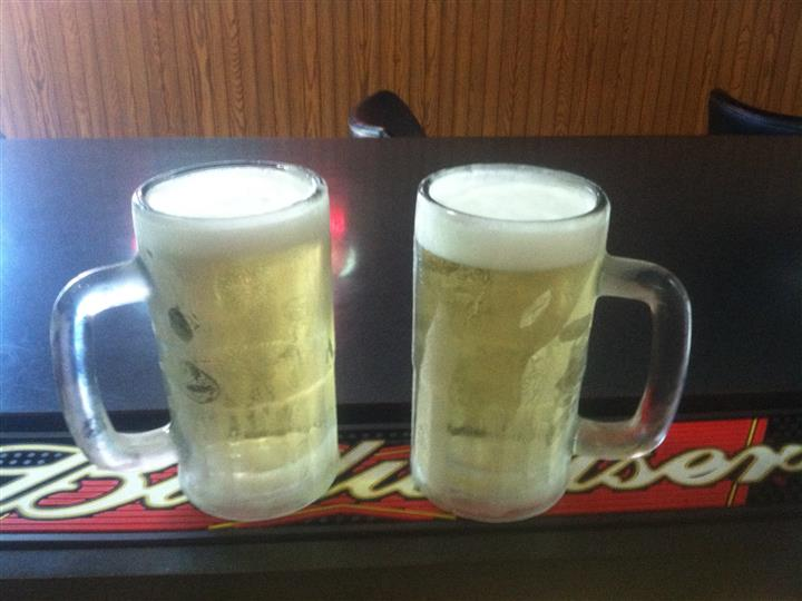 Two full glasses of beer at the bar