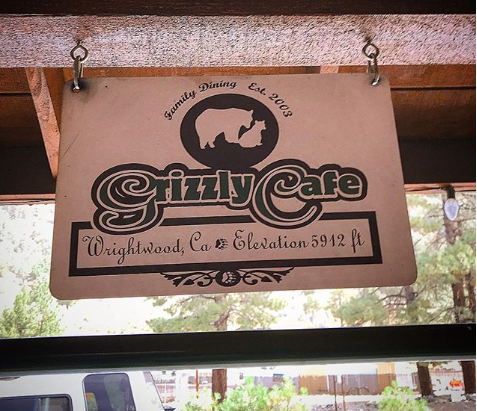 Sign hanging from the ceiling with the Grizzly Cafe logo