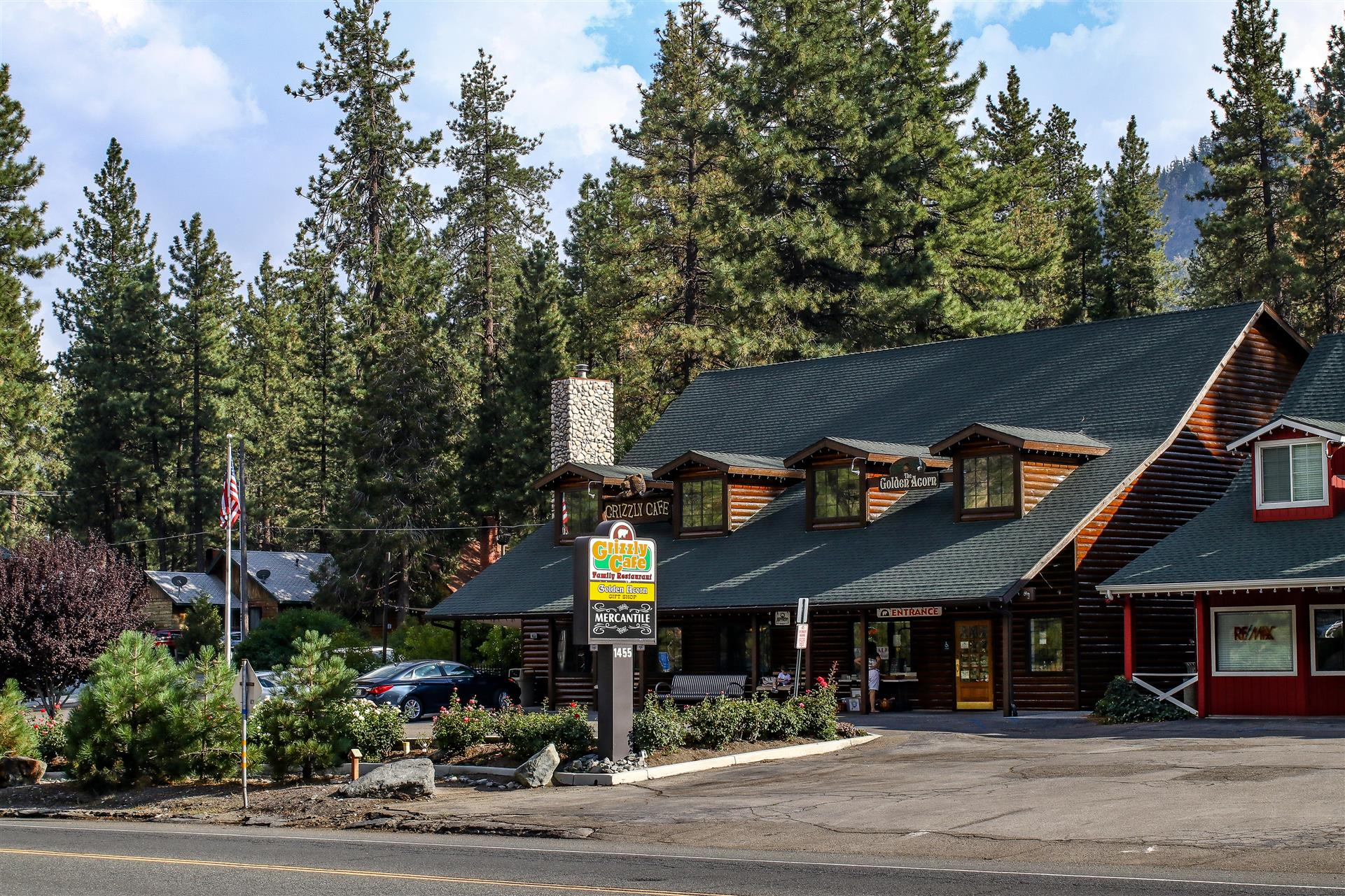 The exterior of Grizzly Cafe and parking lot  from the opposite side of the road