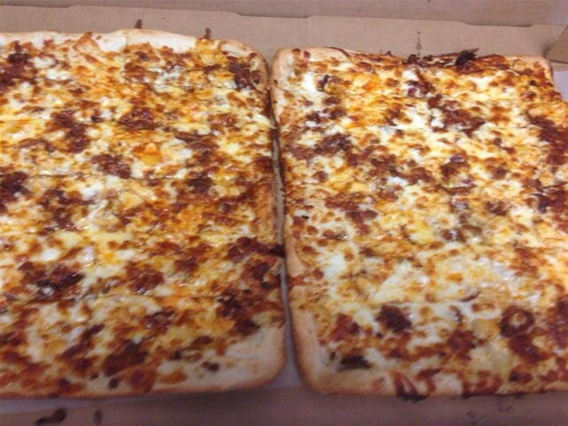 two square pizzas in a box