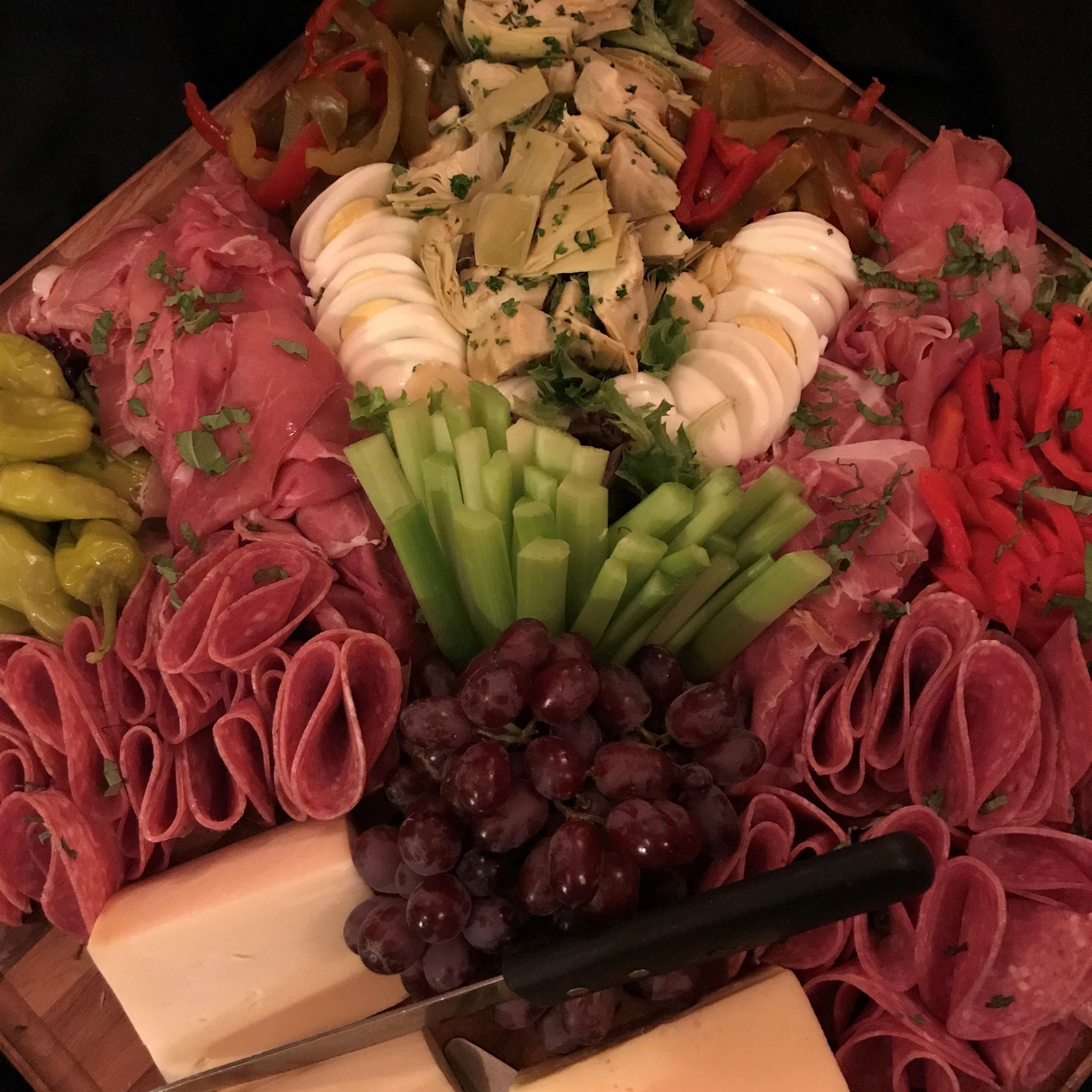 Charcuterie appetizer board with assorted items on display