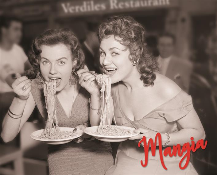 Vintage photo of women in dresses eating spaghetti