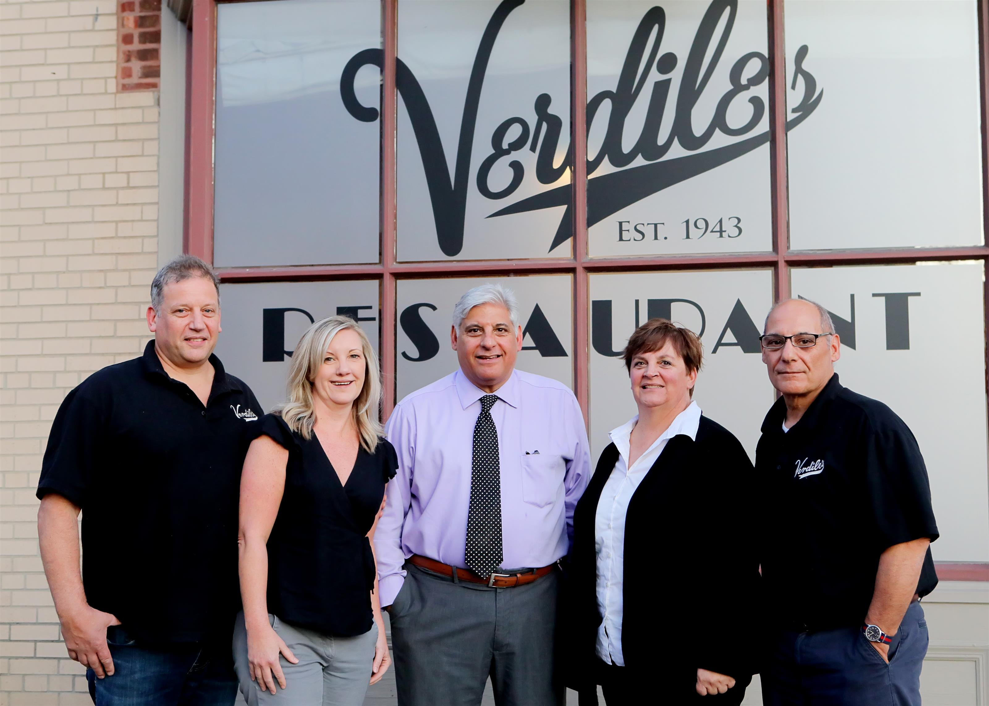 5 people in front of Verdiles restuarant