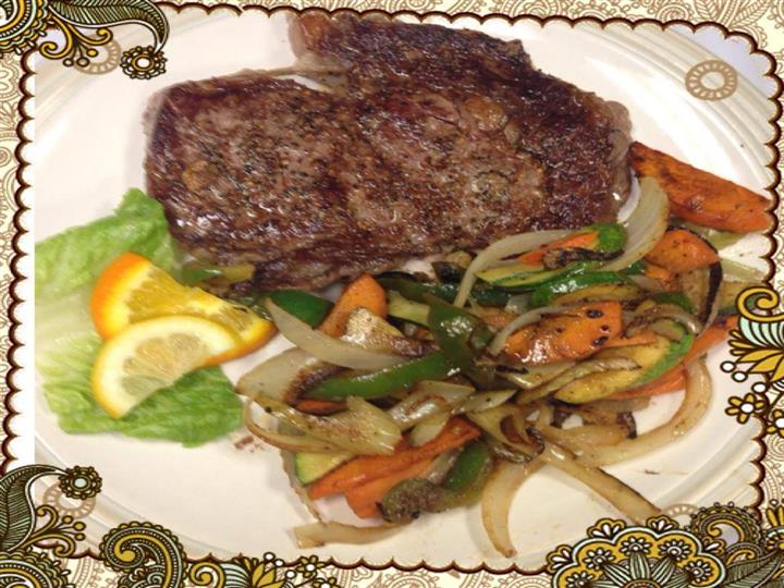 perfectly cooked steak with a side of fresh steamed vegetables
