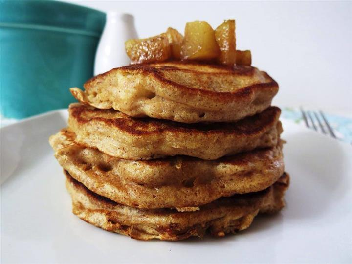 Cinnamon apple pancakes stacked on a plate