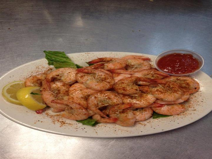 steamed seasoned shrimp with a side of cocktail sauce